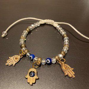 # Evil Eye Clear/Blue/Gold Beaded Bracelet